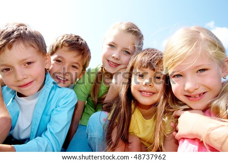 Portrait of cheerful boy and girl looking at camera