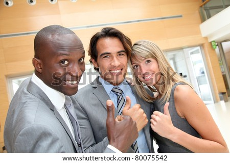 Portrait of cheerful business team