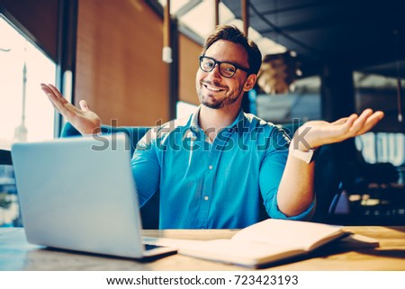 Portrait of cheerful businessman completing work on startup satisfied with making great job.Happy male entrepreneur celebrating new achievements in marketing enjoying creative job and free schedule