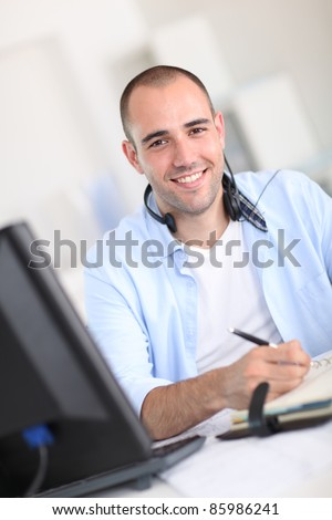 Portrait of cheerful customer service employee
