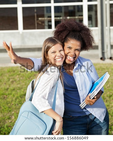 Portrait of cheerful female students making facial expressions on college campus