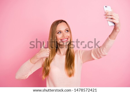 Portrait of cheerful funy lady have adverts advise weekend make photos isolated over pink background