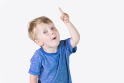 Portrait of cheerful kid boy showing good idea on fingers - isolated over white background