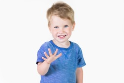 Portrait of cheerful kid boy showing how old he on fingers - isolated over white background