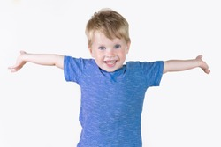 Portrait of cheerful kid boy showing something big with his hands, hands to the side - isolated over white background