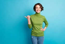 Portrait of cheerful lady direct thumb finger empty space demonstrate adverts wear casual clothes isolated blue color background