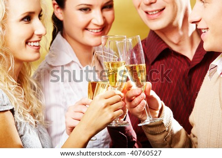 Portrait of cheerful people toasting at party with smiles