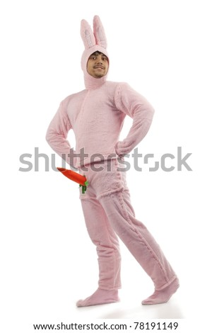Portrait of cheerful pink rabbit is proud of his carrot isolated on white background