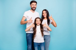 Portrait of cheerful positive three brunet hair people promoters show thumb up recommend sales wear white t-shirt denim jeans casual outfit isolated over blue color background