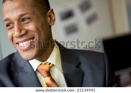Portrait of cheerful professional looking aside and laughing