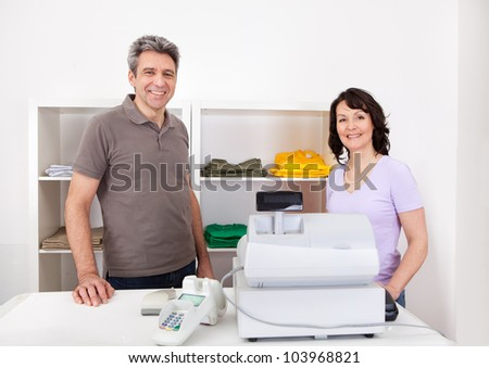 Portrait of cheerful sales persons in the retail store