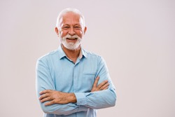 Portrait of cheerful senior man who is looking at camera and smiling.