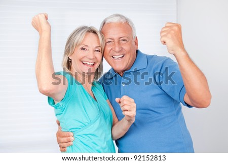 Portrait of cheerful senior man with happy mature woman