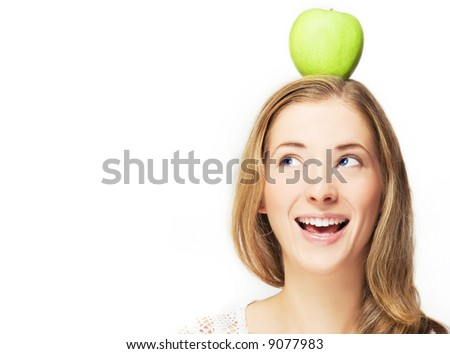 portrait of cheerful woman with apple on her head, over white