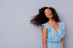 Portrait of cheerful young african american woman with curly hair laughing
