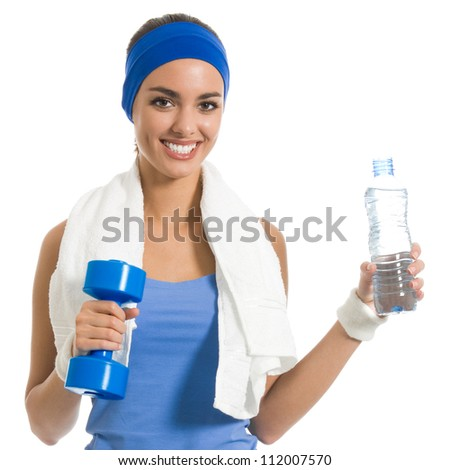 Portrait of cheerful young attractive woman in fitness wear with dumbbell and water, isolated over white background