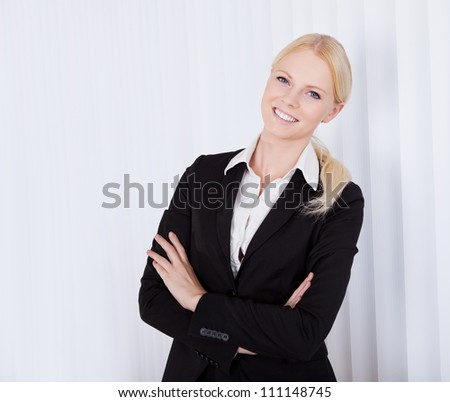 Portrait of cheerful young businesswoman in the office