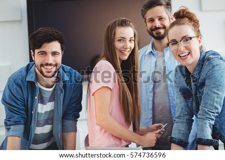 Portrait of cheerful young editors at creative office #574736596