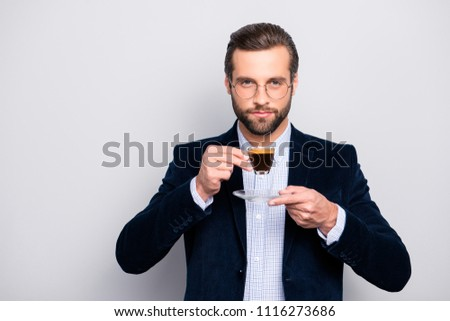 Portrait of chic handsome pleased delightful serious attractive dreamy wealthy elegant classy man smelling the aroma of fresh bitter coffee isolated on gray background copy-space #1116273686