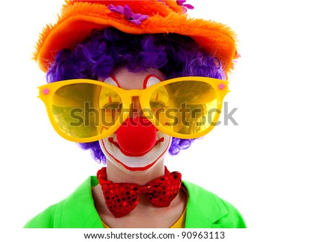 portrait of child dressed as colorful funny clown over white background
