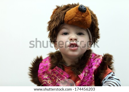 Portrait of child in a bear suit