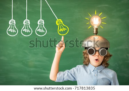 Portrait of child in classroom. Kid with toy virtual reality headset in class. Success, idea and creative concept. Back to school