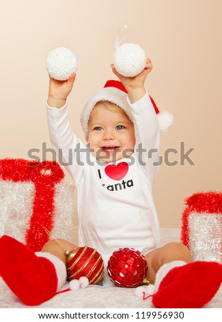 Portrait of child posing in studio in christmas with presents