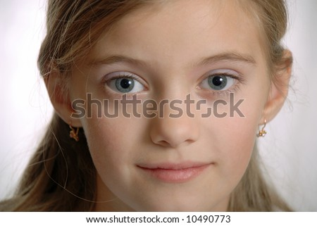 Portrait of child with inquisitive, amicable sight, pure grey eyes,