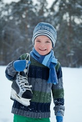 Portrait of child with skates, winter
