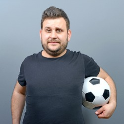 Portrait of chubby man holding football - Football fan supporter or player concept