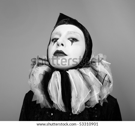 Portrait of Circus fashion mime posing on a grey background. Black&White Photo.