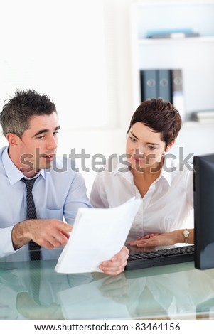 Portrait of colleagues looking at documents in an office