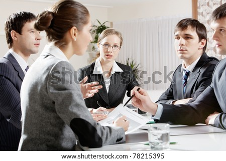 Portrait of colleagues planning their work and discussing it in office