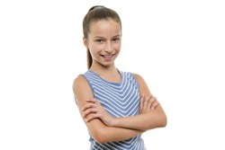 Portrait of confident beautiful young smiling girl with arms crossed. Child with perfect white smile, isolated on white background.