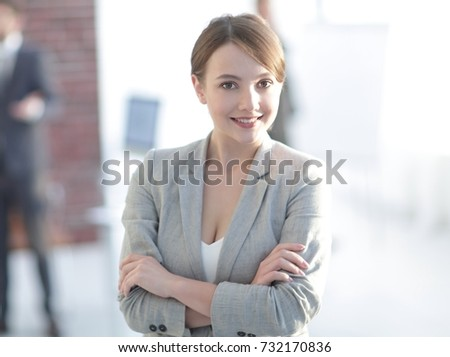 portrait of confident business woman on the background of the office. #732170836