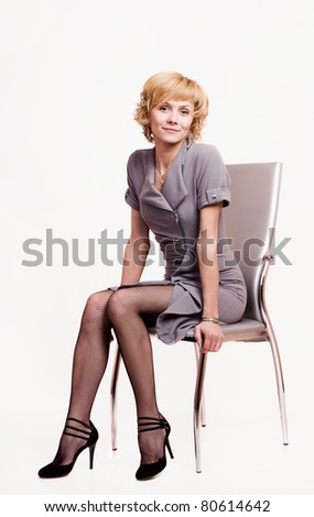 Portrait of  confident business woman over white