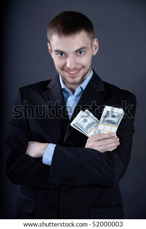 Portrait of confident businessman with dollars