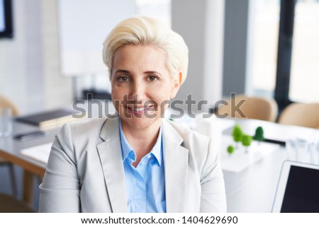 Portrait of confident businesswoman in the office  #1404629690