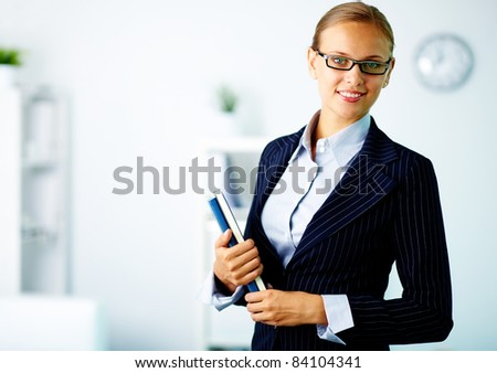 Portrait of confident businesswoman looking at camera in office
