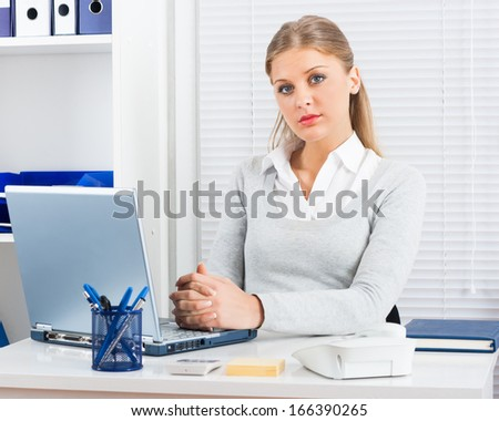 Portrait of confident businesswoman sitting in her office,I'm the boss