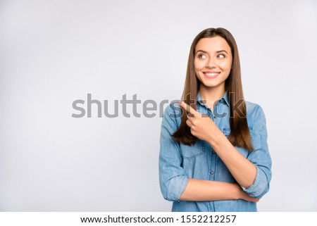 Portrait of confident cool promoter girl look adverts enjoy point index finger recommend suggest sales discounts wear casual style outfit isolated over white color background