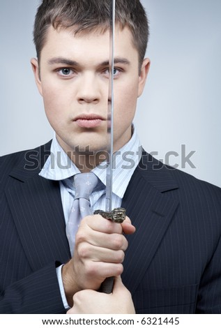 portrait of confident corporate worker with sword