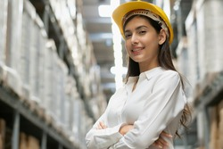 Portrait of confident factory woman in arms crossed smiling to camera. Female worker working for logistic business shipping and delivery service. copy space