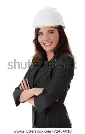 Portrait of confident female worker in white helmet