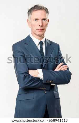 Portrait of confident mature businessman with arms crossed