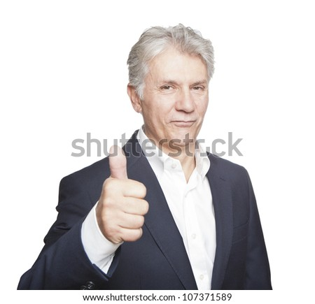 Portrait of confident mature businessman with  thumbs up on white background