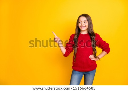 Portrait of confident positive cool child promoter point index finger copyspace choose decide advise adverts recommend promo wear red pullover denim jeans isolated over yellow color background