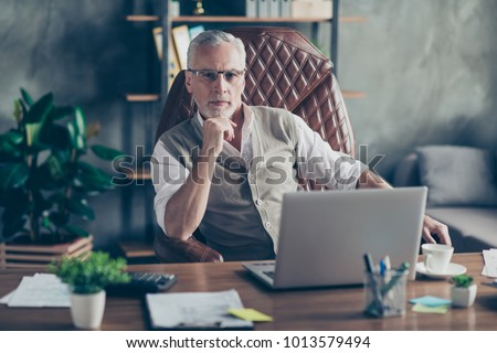 Portrait of confident serious strict concentrated pensive qualified smart clever self-assured head of a company dressed in waist coat thinking dreaming planning analyzing imagining strategy start-up