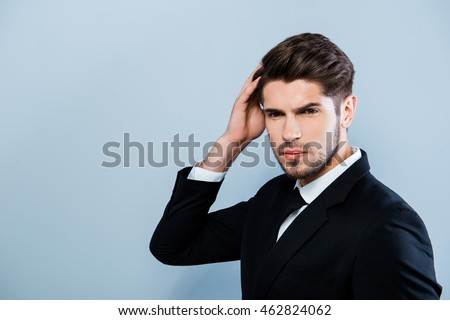 Shutterstock Portrait of confident sexy businessman touching his hair