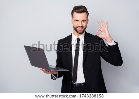 Portrait of confident smart entrepreneur man hold computer work project approve show okay sign wear formalwear outfit isolated over grey color background Stock photo ©